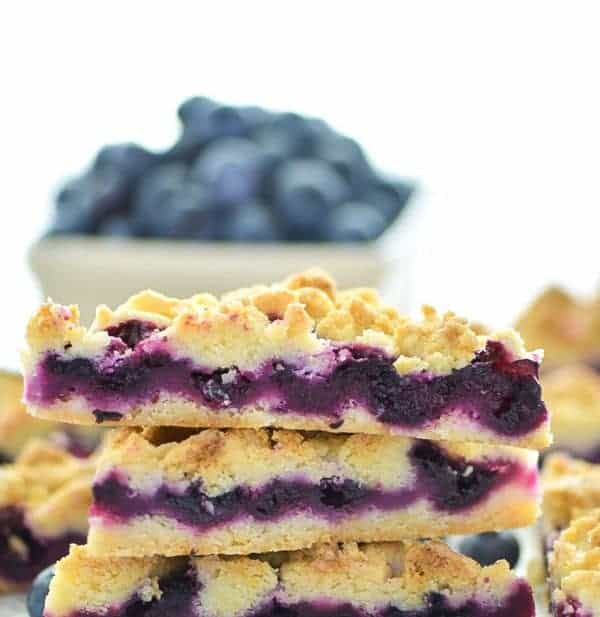 These Gluten Free Blueberry Crumb Bars are made with fresh blueberries and are a really delicious dessert or snack. The crumb is nice and crisp and the lemon zest makes these bright and fresh! Recipe from @whattheforkblog | whattheforkfoodblog.com | gluten free dessert recipes | easy gluten free desserts | summer recipes | summer desserts | recipes for fresh blueberries | fruit desserts