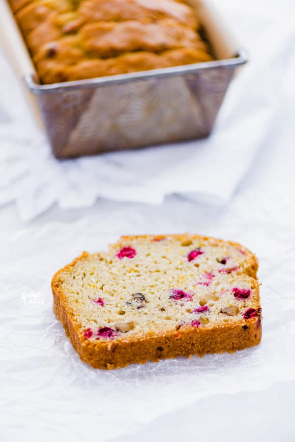 Gluten Free Cranberry Bread is the perfect holiday loaf! It's got a dairy-free option too! It's full of flavor thanks to orange zest and extract and fresh cranberries and can be made with dried cranberries. This gluten free quick bread is easy and simple to make. You'd never know it was gluten free! It's great for gifting too and can be made as four mini loaves. Gluten free bread recipe from @whattheforkblog - visit whattheforkfoodblog.com for more! #glutenfree #quickbread #glutenfreebread