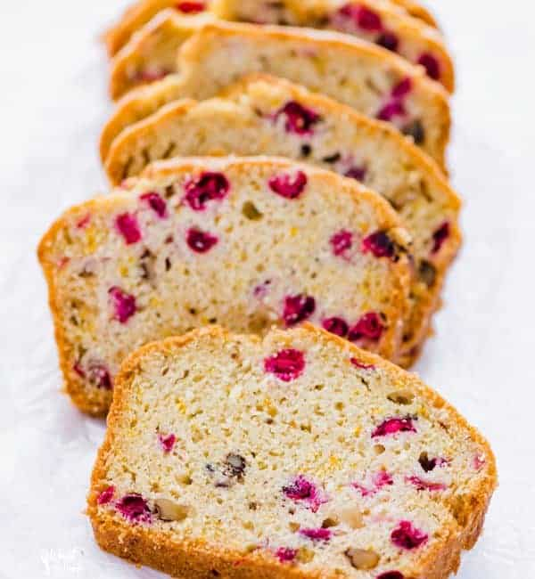 sliced gluten free cranberry orange bread on wax paper