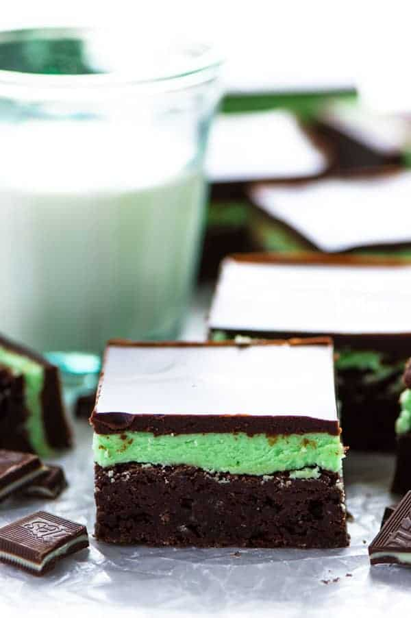 Mint Flourless Brownies topped with mint buttercream (make it with or without the green coloring) and chocolate ganache - these are a mint lover's dream dessert! They're really easy to make too! Recipe from @whattheforkblog | whattheforkfoodblog | gluten free brownies | homemade brownie recipe | how to make brownies without flour | mint desserts | easy dessert recipes | #glutenfree #brownies #mint #buttercream #dessert #easyrecipes #chocolate Chocolate Mint Brownies