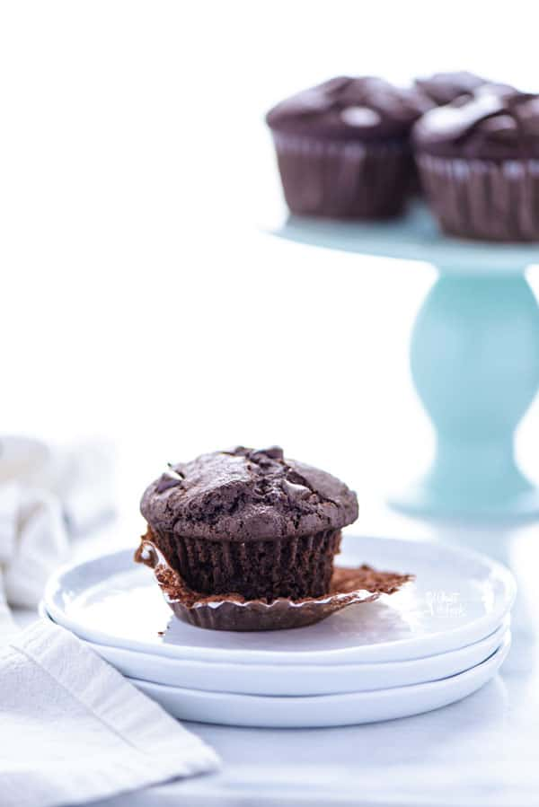 Bakery Style Gluten Free Double Chocolate Chip Muffins are moist muffins full of chocolate flavor. They've got a tender crumb and are light and fluffy - no gritty texture in this gluten free muffin recipe! Make them ahead for quick breakfasts in the morning (great for meal prep!) or make them for weekend brunch. This gluten free breakfast recipe is always a hit and it's a super kid-friendly meal or snack.