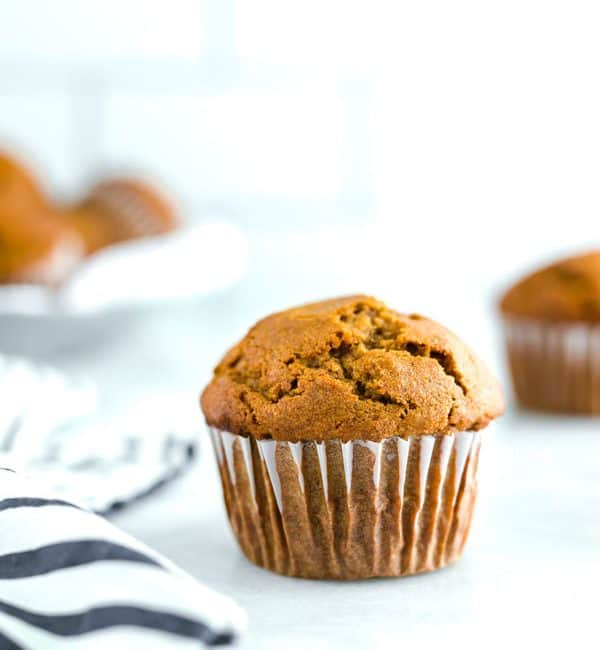 Gluten free pumpkin muffins make the perfect Fall breakfast. Full of pumpkin flavor and warm spices, these muffins pair nicely with a cup of coffee or hot tea. You can make them ahead and freeze for quick weekday breakfasts or make them for lazy Saturday breakfasts or Sunday brunch. Add nuts or raisins if you want! Gluten Free Muffins recipe from @whattheforkblog - visit whattheforkfoodblog.com for more! #glutenfree #breakfast #muffins #glutenfreemuffins #pumpkin #pumpkinmuffins #pumpkinrecipes