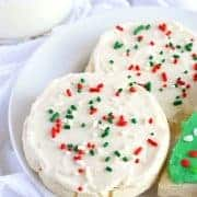 These cut out, no chill Gluten Free Frosted Sugar Cookies are a must-make this holiday season. Gift them, leave them on a plate for Santa, or hoard them for yourself. Gluten free and dairy free recipe @whattheforkblog | www.whattheforkfoodblog.com | sponsored | gluten free sugar cookies | how to make gluten free sugar cookies | lofthouse sugar cookies | frosted sugar cookies | dairy free sugar cookies | vegan frosting | sprinkles | frosting for sugar cookies | gluten free cookies