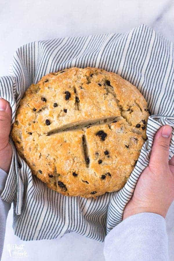 hands holding gluten free Irish Soda Bread for St. Patrick's Day