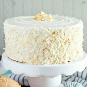 Gluten Free Coconut Cake (and dairy free). This cake is the ultimate dessert for coconut lovers! From @whattheforkblog | whattheforkfoodblog.com