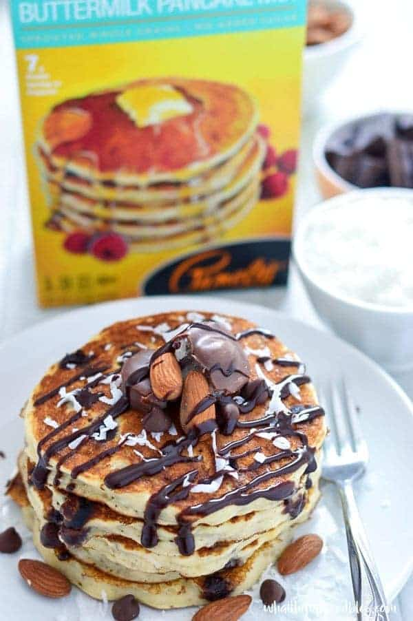 Gluten Free Almond Joy Pancakes - your favorite candy bar flavors (coconut, chocolate, and almond) in pancake form. Perfect for breakfast, brunch, or dinner. Recipe from @whattheforkblog | whattheforkfoodblog.com | Sponsored by Pamela's