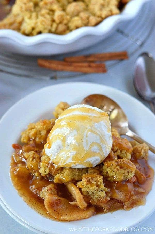 Gluten Free Caramel Apple Crisp for the perfect fall dessert. Dairy free option. Recipe from @whattheforkblog | whattheforkfoodblog.com | Desserts for fall | apple recipes | how to make apple crisp | apple crisp recipe | easy apple crisp |