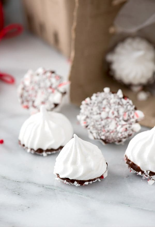 Chocolate Peppermint Dipped Meringue Cookies plus a complete list of gluten free Christmas cookies for all your holiday baking. | @whattheforkblog | whattheforkfoodblog.com