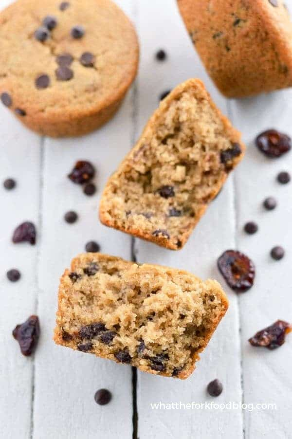 Gluten Free Cranberry Chocolate Chip Muffins - nut free and vegan (top 8 free). Easy breakfast recipe from @whattheforkblog | whattheforkfoodblog.com | sponsored | gluten free breakfast recipes | gluten free muffins | vegan recipes | allergy-friendly | Christmas brunch ideas | easy breakfast ideas | gluten free baking | muffin mix hack