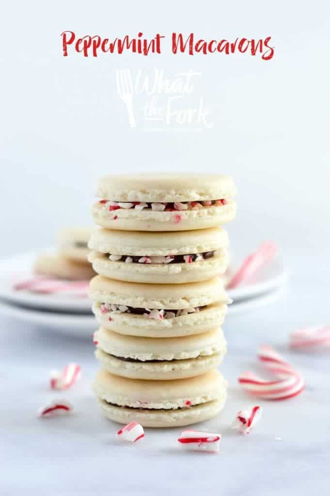 Gorgeous Macarons flavored for Christmas! These peppermint macarons are made with a basic macaron shell and filled with peppermint chocolate ganache and crushed candy canes - they're heavenly! Gluten free and dairy free macaron recipe from @whattheforkblog | whattheforkfoodblog.com | Sponsored | how to make macarons | easy macaron recipe | french macarons | french macaron filling | french macaron flavors | macaron recipe flavors