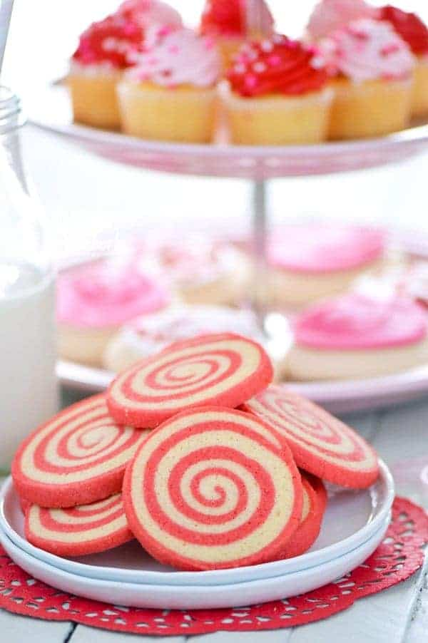 Sweet, crispy Gluten Free Cherry Pinwheel Cookies are a fun twist on a classic cookie recipe and are easier to make then you'd think. The pretty red swirl also makes them great for Valentine's Day! Recipe from @whattheforkblog | whattheforkfoodblog.com | gluten free cookie recipes | pinwheel cookie recipes | how to make pinwheel cookies