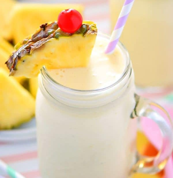 These Healthy Pina Colada Smoothies are dairy free, gluten free, and paleo. They make a great breakfast or quick afternoon drink and will have you dreaming of sunshine and warm beach weather! Recipe from @whattheforkbog | whattheforkfoodblog.com | smoothie recipes | easy smoothie recipes