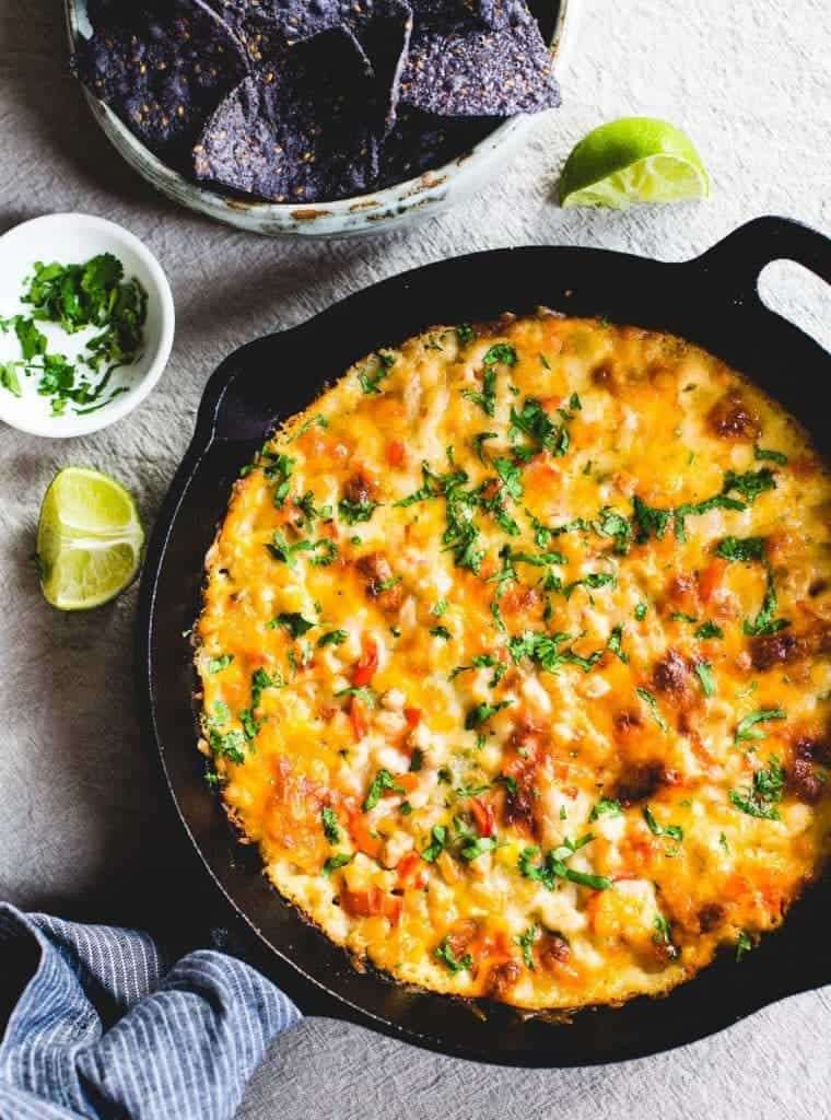 Skillet White Chicken Chili Dip plus MORE gluten free snacks and appetizers perfect for game day or parties! | @whattheforkblog | whattheforkfoodblog | game day food | party food | gluten free appetizers | gluten free snacks | finger foods and dips