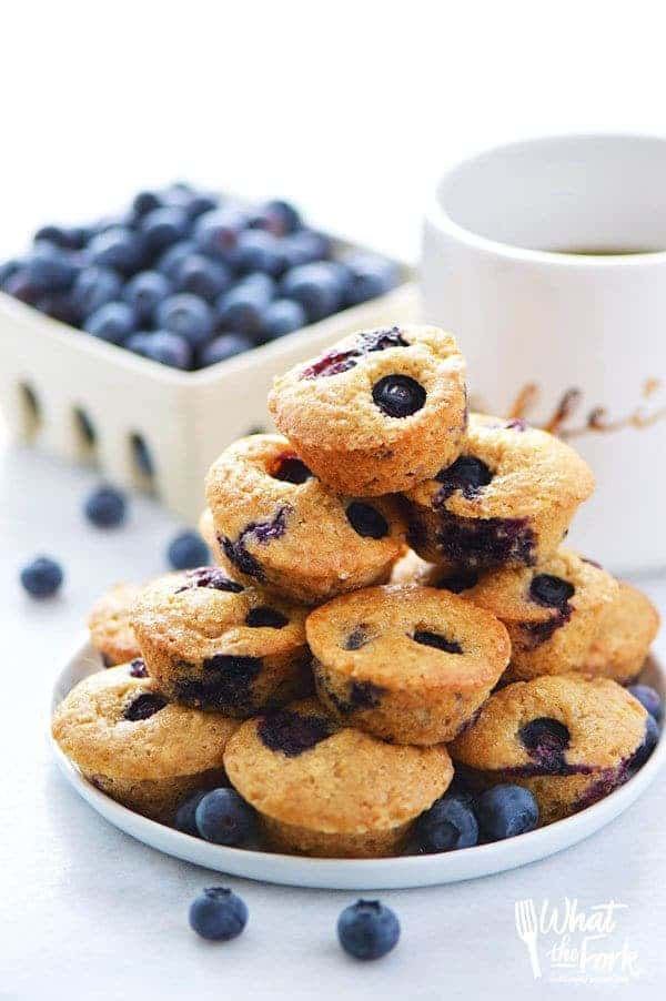 Quick and easy Gluten Free Mini Blueberry Muffins make a great grab-and-go breakfast or snack. Recipe from @whattheforkblog | whattheforkfoodblog.com | gluten free breakfast recipes | blueberry mini muffins | blueberry muffins recipe | muffin recipes | best blueberry muffins | homemade blueberry muffins | dairy free muffin recipes | gluten free muffins |