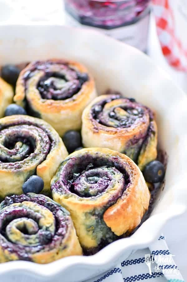 1-Hour Gluten Free Blueberry Sweet Rolls - perfect for brunch! Recipe from @whattheforkblog | whattheforkfoodblog.com | Sponsored by Bonne Maman | gluten free baking | easy gluten free recipes | gluten free bread recipes | yeast rolls | brunch recipes | sweet roll recipes | homemade dough recipes |