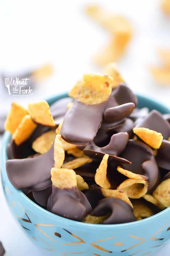 Chocolate Dipped Fritos (aka Fritos Jets) are a delicious salty-sweet snack! They're great for parties! Easy recipe from @whattheforkblog | whattheforkfoodblog.com | gluten free snacks | appetizers | chocolate covered | sweet and salty | chips | Sponsored by Frito Lay