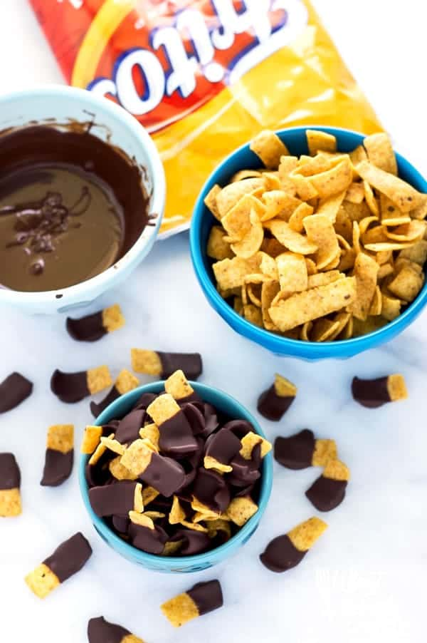 Chocolate Dipped Fritos (aka Fritos Jets) are a delicious salty-sweet snack! They're great for parties! Easy recipe from @whattheforkblog | whattheforkfoodblog.com | gluten free snacks | appetizers | chocolate covered | sweet and salty | chips | Sponsored by Frito Lay | snack foods | easy snacks | no-bake recipes