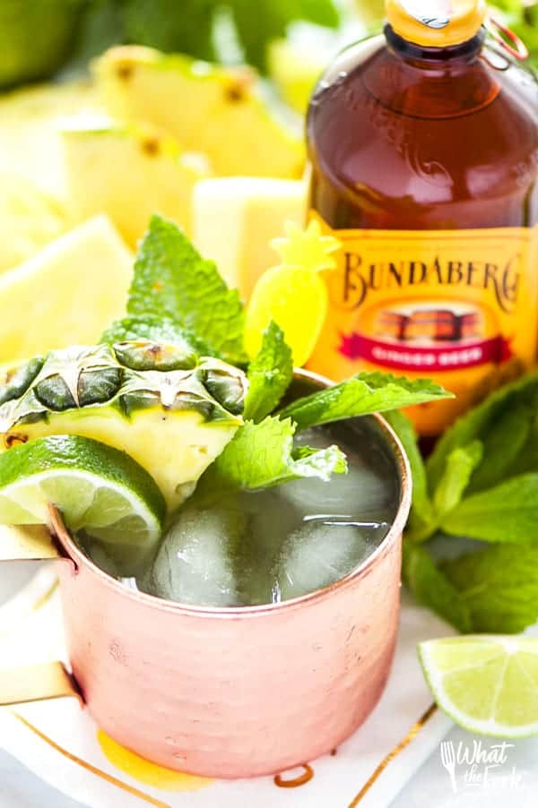 This simple Pineapple Moscow Mule recipe is SO easy. This drink is so refreshing and perfect for summer. Can easily be made without alcohol too. Recipe from @whattheforkblog | Sponsored by Bundaberg Brewed Drinks | whattheforkfoodblog.com | summer drinks | easy cocktail recipes | drinks with pineapple | vodka | cocktail recipes