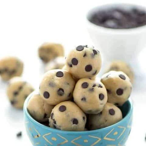 Gluten Free Edible Chocolate Chip Cookie Dough (egg free recipe with a dairy free + vegan option). No bake chocolate chip cookie dough bites. Recipe from @whattheforkblog | whattheforkfoodblog.com | easy gluten free desserts | no-bake recipes | summer desserts | edible cookie dough | gluten free dairy free recipes #glutenfree #vegan #cookiedough #chocolatechip #chocolate