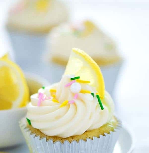 Gluten Free Lemon Cupcakes with Cream Cheese Frosting - these are full of lemon flavor with the perfect cake texture! Recipe from @whattheforkblog | whattheforkfoodblog | gluten free cupcakes | gluten free desserts | gluten free baking | gluten free cake recipes | birthday cake ideas | cupcake recipes | lemon desserts