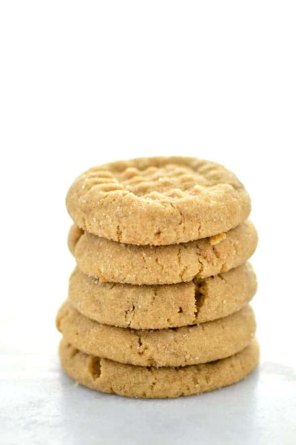 Gluten Free Peanut Butter Cookies - these classic cookies are one that everybody loves! They're easy to make too! Recipe from @whattheforkblog | whattheforkfoodblog.com | gluten free cookie recipes | easy gluten free cookies | gluten free dessert recipes | easy gluten free desserts | peanut butter cookie recipes | how to make peanut butter cookies | homemade peanut butter cookies | holiday baking | gluten free baking