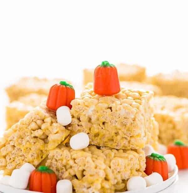 Pumpkin Spice Rice Krispies Treats are the perfect fall flavored no-bake treat. They've got that pumpkin spice flavor you love without having to turn on the oven. They're really easy to make too! Recipe from @whattheforkblog | whattheforkfoodblog.com | easy gluten free desserts | no-bake dessert recipes | homemade rice krispies treats | pumpkin spice recipes | fall recipes | easy dessert recipes | flavors for Rice Krispies Treats | homemade dessert recipes | updated classics