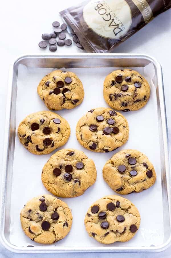 These are the best gluten free chocolate chip cookies you'll ever have! They're buttery, soft in the middle yet firm enough to dunk in a glass of milk. They've got chewy edges and are filled with melt in your mouth chunks of chocolate. Easy to make too! Recipe from @whattheforkblog | whattheforkfoodblog.com | Sponsored | gluten free cookie recipes | homemade cookies | bakery style cookies | gluten free dessert recipes #glutenfree #glutenfreecookies #chocolate #chocolatechipcookies #dessert