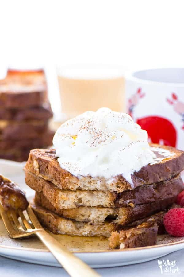 This Gluten Free Eggnog French Toast is the perfect breakfast during the holiday season. You can make it ahead too and reheat it for your holiday brunch! For dairy free, use non-dairy eggnog. Recipe from @whattheforkblog | whattheforkfoodblog.com | recipes for Christmas brunch | gluten free breakfast recipes | easy French toast recipes | #Christmas #frenchtoast #breakfast #glutenfree #easyrecipes #recipe #eggnog #brunch
