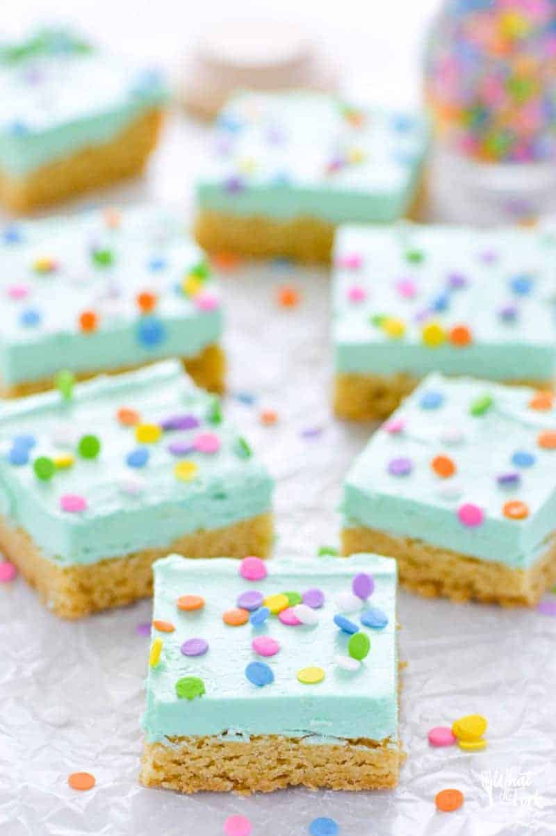 Soft gluten free sugar cookie bars that will bring smiles to the faces of all who eat them! Easier to make than cut out sugar cookies with the same flavor you love. Don't forget the sprinkles! Recipe from @whattheforkblog | whattheforkfoodblog.com | gluten free dessert recipes | gluten free desserts | easy gluten free sugar cookies | bar cookie recipes | easy gluten free recipes | vanilla buttercream frosting recipe | #glutenfree #easyrecipes #glutenfreedessert #dessert #sugarcookies #barcookies #glutenfreecookies