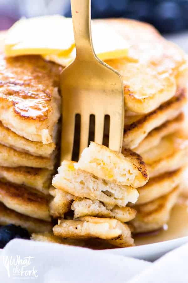 These gluten free pancakes are light, fluffy, and truly the best! They're so easy to make, can be made dairy free, they're naturally sweetened, and they freeze well! Recipe via @whattheforkblog | whattheforkfoodblog.com | gluten free breakfast recipes | fluffy gluten free pancakes | easy gluten free recipes | gluten free brunch | #glutenfree #easyrecipes #pancakes #breakfast #dairyfree #naturallysweetened