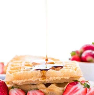 This easy gluten free waffle recipe is a family favorite. We make these waffles almost once a week! They also freeze well so you can make extra for later! They get nice and crispy too, like a Eggo waffles. There's a dairy free option too! Gluten free breakfast recipe from @whattheforkblog | whattheforkfoodblog.com | how to make gluten free waffles | easy recipe for gluten free waffles | brunch recipes | homemade waffles #glutenfree #waffles #breakfast #dairyfree #easyrecipes #brunch #kidfriendly