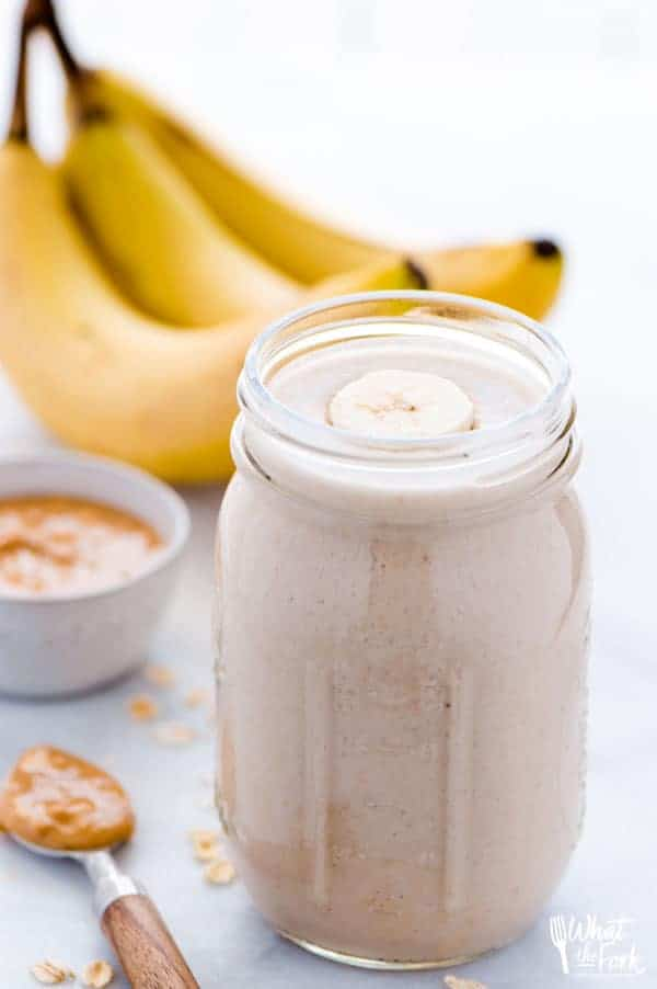 These healthy gluten free peanut butter banana oatmeal smoothies are a hearty and filling breakfast. They're perfect for busy mornings and can be prepped ahead of time. They're easily made dairy free and vegan too! Easy smoothie recipe from @whattheforkblog | whattheforkfoodblog.com | #healthy #smoothies #breakfast #recipe #easyrecipes #oatmeal #oatmealsmoothies