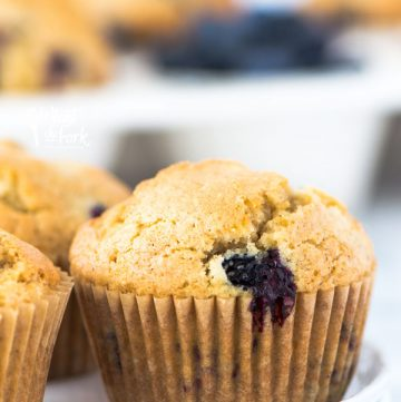 This is a really easy recipe for gluten free blueberry muffins. They're so tender and full of cinnamon flavor - they'll quickly become a go-to breakfast recipe! They freeze well too so go ahead and make a double batch! They're great for busy mornings. From @whattheforkfblog | whattheforkfoodblog.com | gluten free breakfast recipes | gluten free muffin recipes | homemade muffins | #glutenfree #dairyfree #muffins #breakfast #easyrecipes