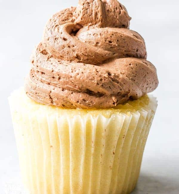 This creamy Homemade Chocolate Frosting recipe is easy to make and calls for simple ingredients. It's great for spreading or piping on cupcakes, cakes, brownies, or cookies. You'll love it! Recipe from @whattheforkblog | whattheforkfoodblog.com | easy homemade frosting recipes | how to make chocolate buttercream frosting | how to make frosting | the best chocolate frosting recipe | #buttercream #chocolate #frosting #dessert #easyrecipes