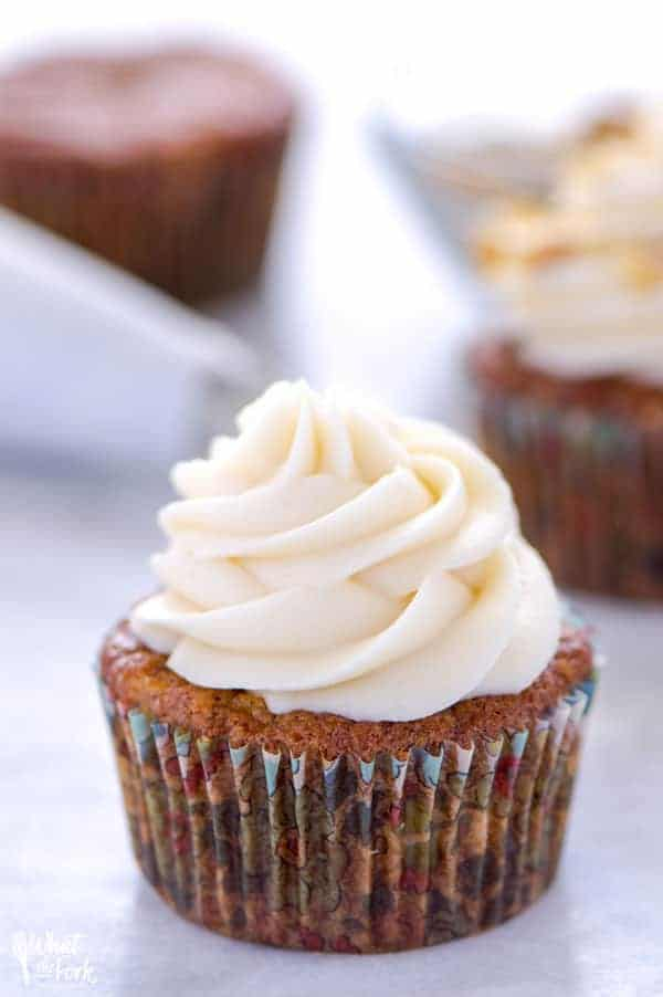 gluten free carrot cake cupcake with cream cheese frosting on platter