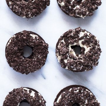 6 Yummy Gluten Free Cookies and Cream Donuts on a marble counter top