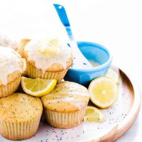 gluten free lemon poppy seed muffins on a brown wood platter