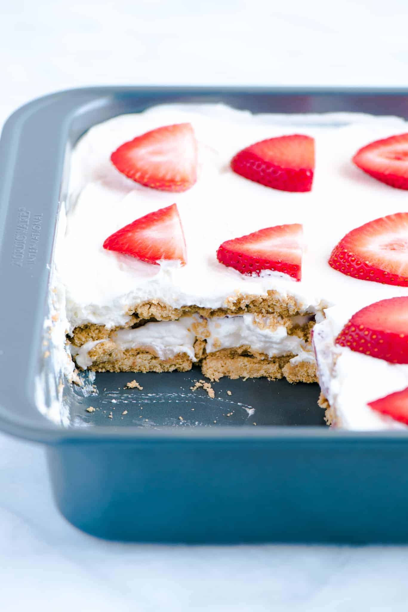 Gluten Free Strawberry Icebox Cake in a metal pan with a slice cut out