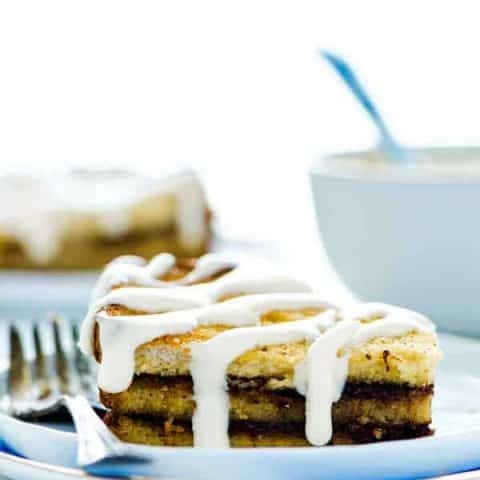 This gluten free Overnight French Toast Casserole with Cinnamon Swirl is a must make for any holiday brunch or potluck! This easy breakfast casserole is complete with cream cheese icing to give it the full cinnamon roll effect. (#dairyfree option included) Made with @udisglutenfree bread - gluten free brunch recipe from @whattheforkblog | visit whattheforkfoodblog.com for more! #glutenfree #breakfast #brunch #holidaymenu #cinnamonswirl #frenchtoast #frenchtoastcasserole #allergyfriendly