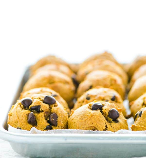 Gluten Free Pumpkin Chocolate Chip Cookies lined on a metal sheet pan