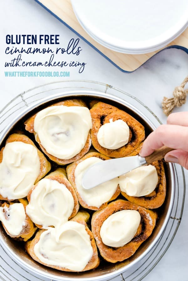 This easy gluten free cinnamon rolls recipe is one that you MUST make! Soft, yeasty rolls with a buttery cinnamon filling and topped with cream cheese icing. Perfect for weekend brunch, breakfast, or holiday brunch! You can even make these gluten free cinnamon rolls dairy free, too! Gluten free bread recipe from @whattheforkblog - visit whattheforkfoodblog.com for more! #glutenfree #cinnamonrolls #brunch #glutenfreebaking #sweetrolls #baking #glutenfreerecipes
