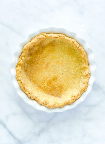 A blind baked pie crust in a white pie plate