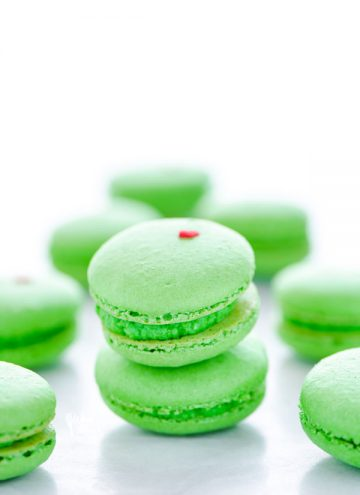 A short stack of green Grinch Heart French Macarons