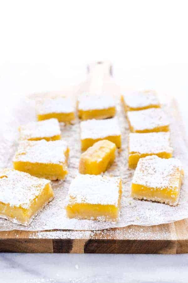 This is the best recipe for gluten free Meyer Lemon Bars! They're simple and easy to make and are tangy, citrusy, and gooey with an incredible shortbread crust! They're perfect for Easter, baby showers, bridal showers, or any celebration. This easy recipe for lemon bars is one you have to try - they're simply irresistible! Helpful post/guide includes lots of tips! Gluten Free Desserts recipe from @whattheforkblog - visit whattheforkfoodblog.com for more! #glutenfree #lemon #MeyerLemon #desserts