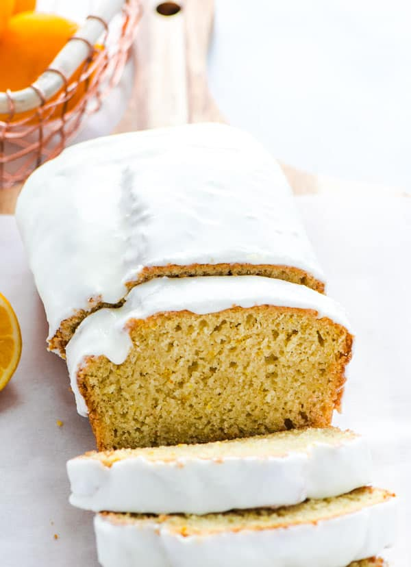 Sliced Gluten Free Meyer Lemon Bread with glaze for the March Gluten Free Baking Challenge.