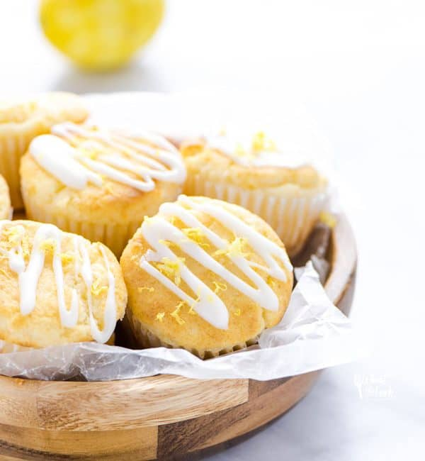 Gluten Free Lemon Ricotta Muffins in a wooden bowl lined with wax paper