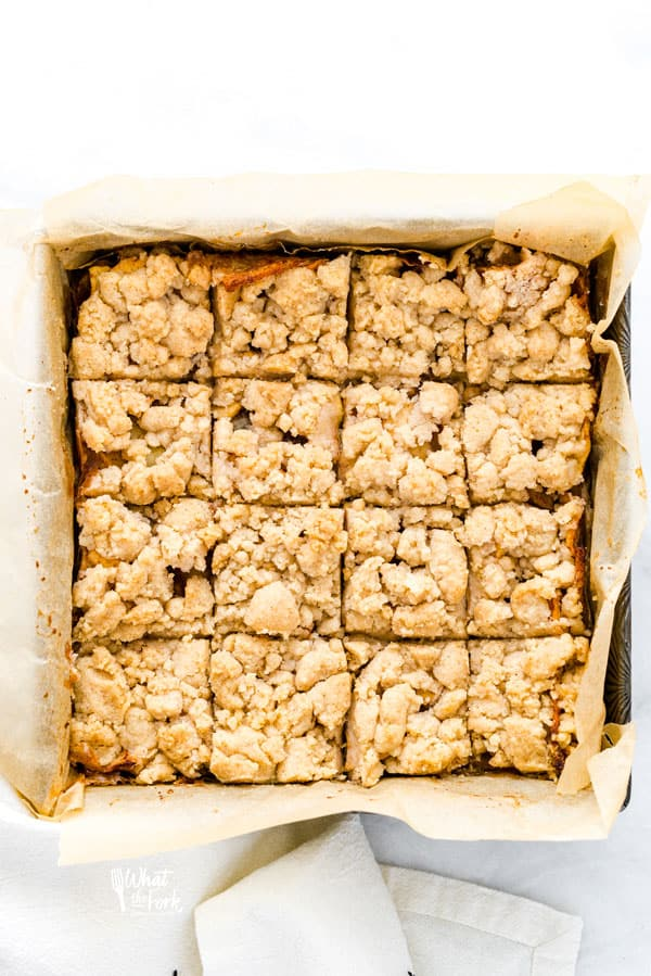 Sliced Gluten Free Apple Pie Bars in an 8x8 baking pan
