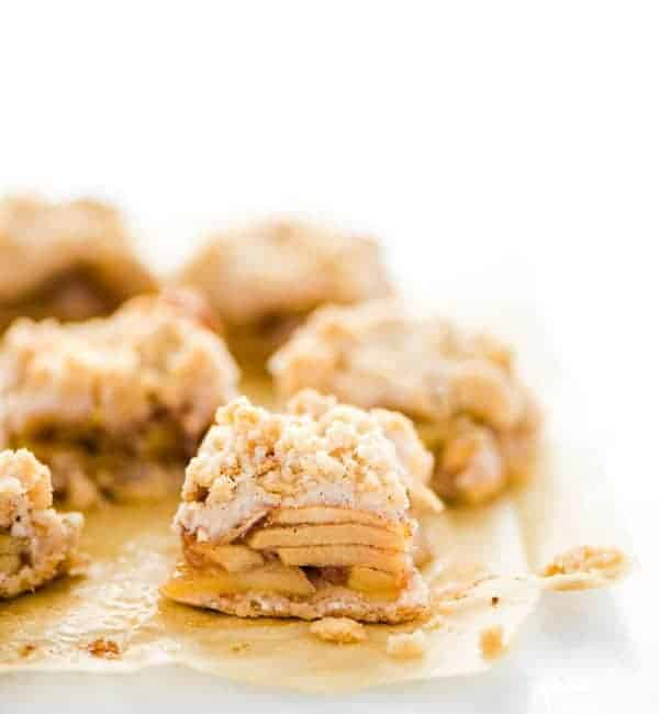 Sliced Gluten Free Apple Pie Bars on unbleached parchment paper