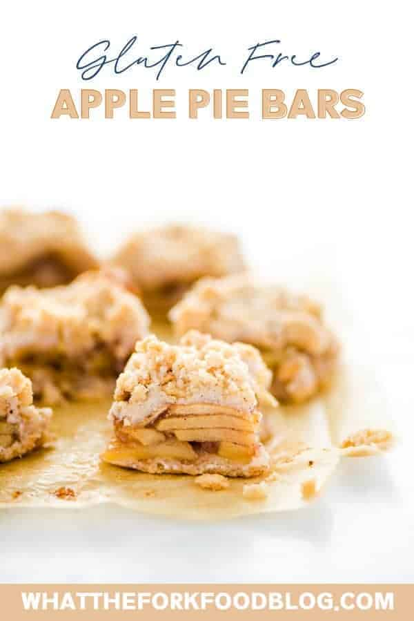 These easy Gluten Free Apple Pie Bars taste just like apple pie but are less work to make! They have a shortbread-like crust, homemade apple pie filling, and crumb topping. The topping is from the same dough as the crust so they're simple to make! For an even easier version, use a can of apple pie filling! This is a great fall dessert recipe that's perfect for harvest parties, Halloween parties, and potlucks. Visit whattheforkfoodblog.com for more! #glutenfree #applpie #applerecipes #desserts