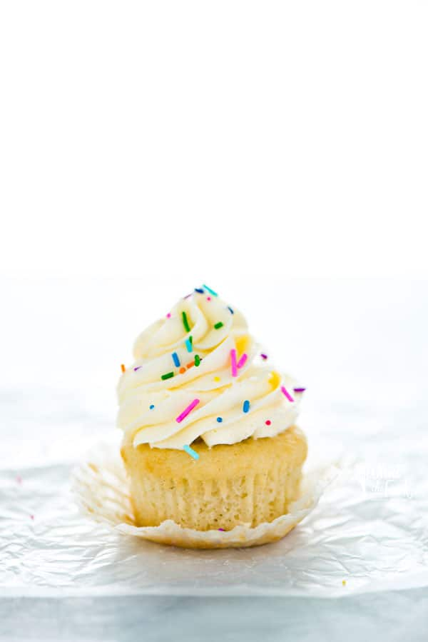 This is an easy recipe for one dozen gluten free vanilla cupcakes. These homemade gluten free cupcakes are way better than store-bought cake mix and the cupcakes are light and moist! Make this gluten free vanilla cupcake recipe for your next birthday party, classroom party, bake sale, or whenever you feel like having a good vanilla cupcake! Gluten free cupcake recipe from @whattheforkblog - visit whattheforkfoodblog.com for more gluten free desserts! #glutenfree #cupcakes #cupcake #birthdaycake